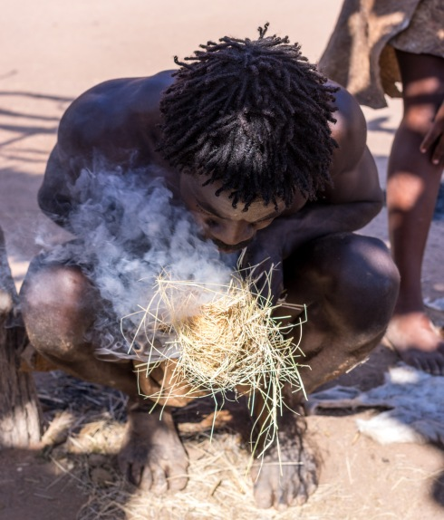 A Damara demonstrates traditional techniques of making fire.