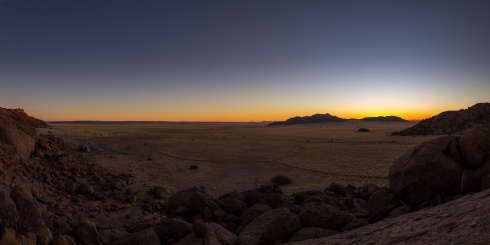 A panorama of a sunset over the Namib region, Namibia.