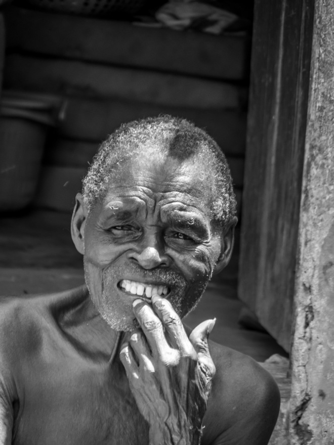 An elder is curiously looking into the camera in Bobikuma, Ghana.