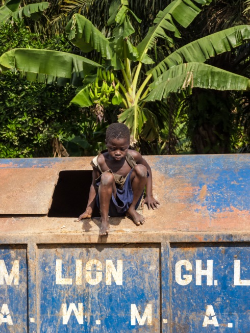 A child playing hide and seek in Agona Swedru, Ghana.