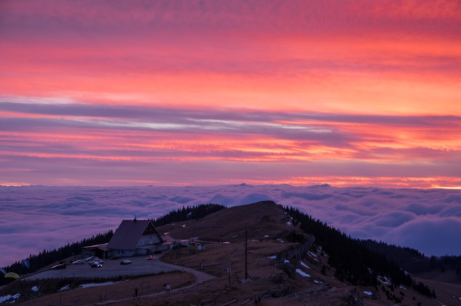 The sun sets over the hotel on top of Chasseral, Switzerland.